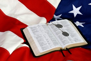Smaller size Bible on top of Flag