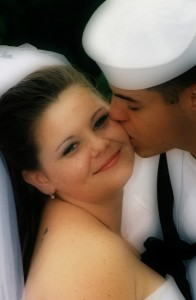 A sailor kissing his new wife.